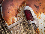 Tail light in a yard full of auto and truck parts, grills, headlights, Golconda, Nev.