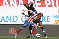 Atletico de Madrid's Filipe Luis (l) and Granada's Allan Romeo Nyom during La Liga match.April 14,2013. (ALTERPHOTOS/Acero)
