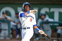 Errol Robinson (9) of the Ogden Raptors follows through on his swing against the Grand Junction Rockies during the Pioneer League game at Lindquist Field on August 24, 2016 in Ogden, Utah. The Raptors defeated the Rockies 11-10. (Stephen Smith/Four Seam Images)