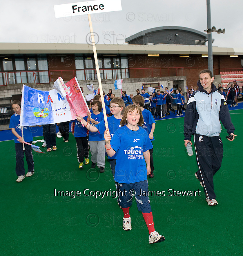 PUPILS FROM FLORA STEVENSON TEAM UP WITH FRANCE AS THEY TAKE PART IN THE OPENING CEREMONY OF THE TOUCH WORLD CUP YOUTH FESTIVAL AT PEFFERMILL.