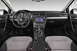 Stock photo of straight dashboard view of a 2015 Volkswagen GOLF e-Golf 5 Door Hatchback 2WD Dashboard