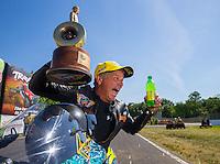 Jun 7, 2015; Englishtown, NJ, USA; NHRA pro stock motorcycle rider Jerry Savoie celebrates after winning the Summernationals at Old Bridge Township Raceway Park. Mandatory Credit: Mark J. Rebilas-