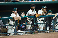 Liover Peguero (center) of the Greensboro Grasshoppers watches from the dugout during the game against the Wilmington Blue Rocks at First National Bank Field on May 25, 2021 in Greensboro, North Carolina. (Brian Westerholt/Four Seam Images)