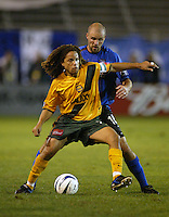Craig Waibel (Earthquakes) and Cobi Jones (Galaxy). Earthquakes defeated Galaxy, 5-2 in overtime at Spartan Stadium on November 9th, 2003.