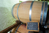 Wine in barrel in the cellar, Tentation cuvee 2007 chateau le bourdillot graves bordeaux france