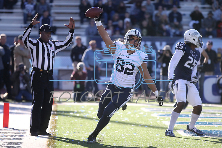 BYU's Kaneakua Friel (82) celebrates after catching a touchdown pass against Nevada's Bryan Lane Jr. during the second half of an NCAA college football game in Reno, Nev., on Saturday, Nov. 30, 2013. BYU defeated Nevada 28-23. (AP Photo/Cathleen Allison)