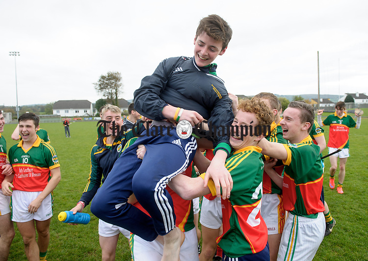 Broadford celebrate their win over Wolfe Tones with James Hannon in the Minor A county final at Sixmilebridge. Photograph by John Kelly.