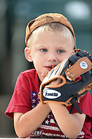 Rochester Red Wings young fan waits for the second game of a doubleheader against the Buffalo Bisons on July 6, 2014 at Frontier Field in Rochester, New  York.  Rochester defeated Buffalo 6-1.  (Mike Janes/Four Seam Images)