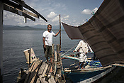 Ernesto, the fisherman poses for a photograph before going away to the sea to catch tuna in Puerto Princesa, Palawan in the Philippines. <br /> Photo: Sanjit Das/Panos for Greenpeace