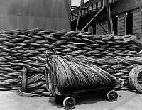 Manufacturing barbed wire.  Wire rods.  Raw material from which steel wire is drawn.  Pittsburgh Steel Co., Monessen, Pa. Ca.  1918.  Pittsburgh Steel Co.   (War Dept.)<br />Exact Date Shot Unknown<br />NARA FILE #:  165-WW-189C-3<br />WAR & CONFLICT BOOK #:  552