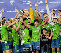 LOS ANGELES, CA - OCTOBER 29: Nicolas Lodeiro #10 and Xavier Arreaga #25 of Seattle Sounders FC hoist the hardware after defeating Los Angeles FC in the MLS Western Conference Final during a game between Seattle Sounders FC and Los Angeles FC at Banc of California Stadium on October 29, 2019 in Los Angeles, California.