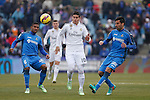 Getafe´s Sammir (L) and Rodriguez and Real Madrid´s James Rodriguez  during La Liga match at Coliseum Alfonso Perez stadium  in Getafe, Spain. January 18, 2015. (ALTERPHOTOS/Victor Blanco)