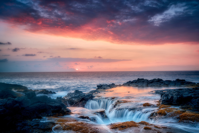 Ocean water drain well and sunset. Hawaii Island. The Big Island