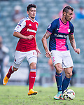 Fernando Recio Comi of Kitchee (R) being followed by Evan Kostopoulos of SCAA (L) during the HKFA Premier League between South China Athletic Association vs Kitchee at the Hong Kong Stadium on 23 November 2014 in Hong Kong, China. Photo by Aitor Alcalde / Power Sport Images
