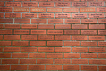 Greenock Morton 2 Stranraer 0, 21/02/2015. Cappielow Park, Greenock. A red brick wall of fame with supporters names inside the stadium, pictured before Greenock Morton take on Stranraer in a Scottish League One match at Cappielow Park, Greenock. The match was between the top two teams in Scotland's third tier, with Morton winning by two goals to nil. The attendance was 1,921, above average for Morton's games during the 2014-15 season so far. Photo by Colin McPherson.