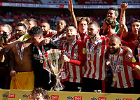 29th May 2021; Wembley Stadium, London, England; English Football League Championship Football, Playoff Final, Brentford FC versus Swansea City; Sergi Canos of Brentford with his team mates celebrate with the Sky Bet EFL Championship Plays-off Trophy after they won 2-0 and promoted to the premier league