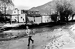 Taos New Mexico pueblo adobe homes native American Indian children playing. 1970s USA