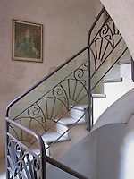 Even this service staircase, which leads up to the servants' quarters, has been given a decorative treatment with wrought-iron work by Martin Vilaseca