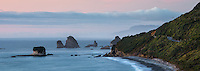 Dusk on wild coastline near Rapahoe near Greymouth with coastal road on right, West Coast, Buller Region, South Island, New Zealand, NZ