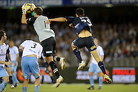 MELBOURNE, AUSTRALIA - FEBRUARY 18, 2010: Nik Mrdja from Melbourne Victory jumps for the the ball in the first leg of the A-League Major Semi Final match between the Melbourne Victory and Sydney FC at Etihad Stadium on February 18, 2010 in Melbourne, Australia. Photo Sydney Low www.syd-low.com