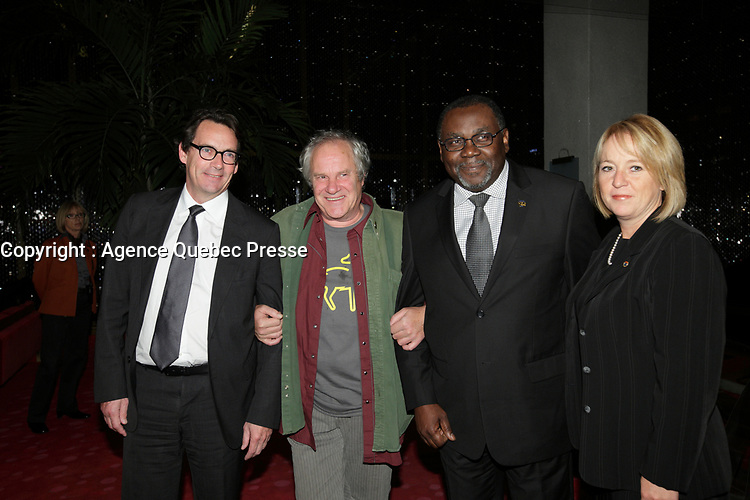 October 10, 2012 - Montreal. Quebec , Canada - Pierre-Karl Peladeau, CEO Quebecor (L)Claude Chamberland (M) and  Maka Kotto , Minister Cultural Affairs, Quebec (R)  at the <br /> Opening of Montreal New Cinema Festival (Festival du Nouveau Cinema de Montreal) at Place des arts  with LA MISE A L'AVEUGLE directed by Simon Galiero.<br /> It was his first speech as Minister.