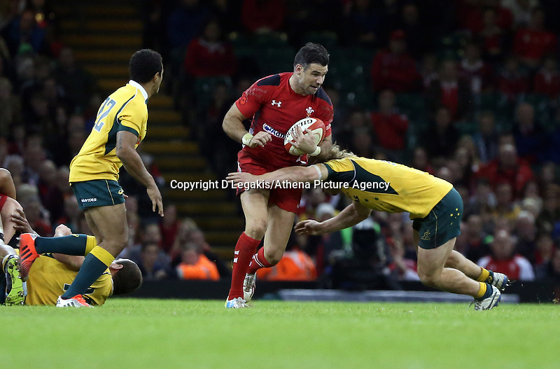 Pictured: Michael Phillips of Wales (C) is brought down by an Australia player Saturday 08 November 2014<br /> Re: Dove Men Series rugby, Wales v Australia at the Millennium Stadium, Cardiff, south Wales, UK.