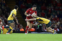 Pictured: Michael Phillips of Wales (C) is brought down by an Australia player Saturday 08 November 2014<br />