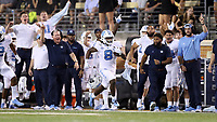 WINSTON-SALEM, NC - SEPTEMBER 13: Michael Carter #8 of the University of North Carolina runs the ball up the sideline for a touchdown during a game between University of North Carolina and Wake Forest University at BB