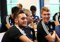 Pictured L-R: Players Matt Grimes, Stephen Kingsley and Jay Fulton with members of staff gather for a meeting in the ground's cafeteria Sunday 28 June 2015<br />