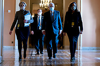 Senate Minority Leader Mitch McConnell, a Republican from Kentucky, center, wears a protective mask while walking to the Senate Chamber at the U.S. Capitol in Washington, D.C., U.S., on Tuesday, Feb. 9, 2021. The Senate begins Donald Trump's second impeachment trial today with a fight over whether the proceeding is constitutional, as a number of conservative lawyers reject the defense team's claim that a former president can't be convicted of a crime by Congress. <br /> CAP/MPI/RS<br /> ©RS/MPI/Capital Pictures