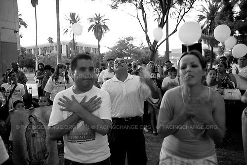 Phoenix, Arizona,<br /> USA <br /> June 2010<br /> <br /> Pro SB 1070 supporters argue with a anti SB 1070 members at a rally on the Arizona State Capitol grounds during a public rally held in favor of Arizona's controversial Senate Bill, 1070 aimed at illegal immigration, Phoenix, Arizona, USA, on 31 July 2010. The state's controversial law went into effect at 12 01 am on 29 July but with a limited effect as Judge Susan Bolton put a injunction on the most controversial parts that many people say was unconstitutional and based on racial profiling.