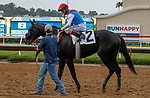 DEL MAR, CA  AUGUST 29:#2 Medina Spirit ridden by John Velasquez, gives the groom congratulatory handshake after winning the Shared Belief Stakes on August 29, 2021 at Del Mar Thoroughbred Club in Del Mar, CA. (Photo by Casey Phillips/Eclipse Sportswire/CSM)