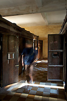 Phnom Penh Town Cambodia, The Ghost of S-21 ? Tuol Sleng In Phnom Penh one of the largest secondary schools under the rule of Pol Pot was turned into a torture camp and prison called S21. ...