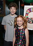"""Finn Faulconer and Charlotte Wise attends the Birthday Party Photo Call for the Wheelhouse Theater Company production of Kurt Vonnegut's """"Happy Birthday, Wanda June""""  on October 3, 2018 at Bond 45 Times Square in New York City."""