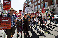 "London, 08/05/2016. Today, ""Campaign Against Climate Change"" held a demonstration to protest against the policies of the British Conservative Government in tackling climate change and to accuse it of not supporting enough clean energy technology. Then protesters, activist and members of the public marched backward from Trafalgar Square to the Department of Energy and Climate Change, Downing Street, Department of Health (Opposite the Treasury). From the organisers Facebook page: <<No more UK backtracking on climate! Since May 2015 clean energy technology has been sidelined in favour of a dash for gas, insulation cut and fracking, roads and runways pushed through despite strong local opposition. So what better way to mark the government's one year anniversary than to march - backwards - down Whitehall? A creative and colourful protest that will make a serious point: we're running out of time to act on climate change, and we can't afford to go backwards. […]>>. The demonstration was supported by: Art Not Oil, Biofuelwatch, Campaign for Better Transport, Client Earth, Climate Revolution, Fuel Poverty Action Group, Global Justice Now, Greenpeace, HACAN, Plane Stupid, Reclaim the Power, Solar Trade Association, Talk Fracking, Time to Cycle, War on Want, The Truth about Zane.<br />