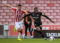 31st October 2020; Bet365 Stadium, Stoke, Staffordshire, England; English Football League Championship Football, Stoke City versus Rotherham United; Mickel Miller of Rotherham United and Tommy Smith of Stoke City chase a lose ball