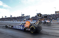 Feb. 24, 2013; Chandler, AZ, USA; NHRA top fuel dragster driver Antron Brown (near lane) races alongside Tony Schumacher during the Arizona Nationals at Firebird International Raceway. Mandatory Credit: Mark J. Rebilas-