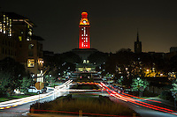 The tower of the Main Building illuminated orange for the 2012 Fall Commencement. The number 12 in lights refers to the graduating class of 2012.