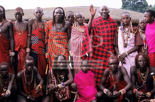 Lolgorian, Kenya. Siria Maasai; members of the Sakaja family outside their manyatta temporary house.
