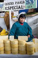 Peru, Cusco, San Pedro Market.  Woman Selling Cheeese.