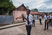 Haiti, Gros-Morne. Mercy Beyond Borders 10th anniversary party. Band playing in the streets to celebrate.