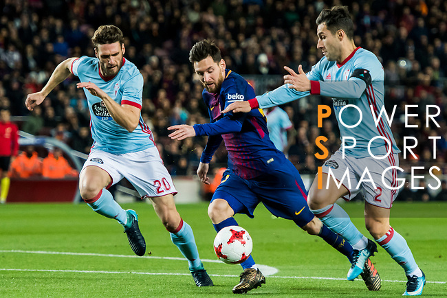 Lionel Andres Messi (C) of FC Barcelona fights for the ball with Sergi Gomez Sola (L) and Hugo Mallo Novegil of RC Celta de Vigo during the Copa Del Rey 2017-18 Round of 16 (2nd leg) match between FC Barcelona and RC Celta de Vigo at Camp Nou on 11 January 2018 in Barcelona, Spain. Photo by Vicens Gimenez / Power Sport Images