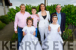 Twin Aisling and Allanah O' Mahoney from Listellick NS stand with their family, Paul, Killian, Rosaleen and Vincent O'Mahoney at their First Holy Communion in St Brendan's Church on Saturday.