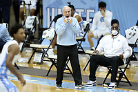 CHAPEL HILL, NC - FEBRUARY 24: Head coach Roy Williams of North Carolina encourages his players during a game between Marquette and North Carolina at Dean E. Smith Center on February 24, 2021 in Chapel Hill, North Carolina.