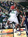 North Texas Mean Green forward George Odufuwa (4) drives in hard for a lay up in the game between the Jackson State Tigers and the University of North Texas Mean Green at the North Texas Coliseum,the Super Pit, in Denton, Texas. UNT defeated Jackson 68 to 49