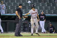 A Kannapolis Intimidators bat bot delivers baseball to home plate umpire Bryan Van Vranken during the game against the Hagerstown Suns at Kannapolis Intimidators Stadium on August 26, 2019 in Kannapolis, North Carolina. The Suns defeated the Intimidators 4-1. (Brian Westerholt/Four Seam Images)