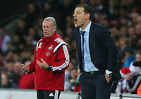 Swansea City caretaker manager Alan Curtis and West Ham United manager Slaven Bilic during the Barclays Premier League match between Swansea City and West Ham United played at The Liberty Stadium, Swansea on 20th December 2015