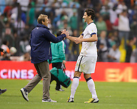 Mexico City, Mexico -Tuesday, March 26 2013: USA ties Mexico 0-0 during World Cup Qualifying at Estadio Azteca. Omar Gonzales congratulates head coach Jurgen Klinsmann after the match.