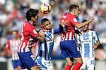 CD Leganes' Youssef En-Nesyri (c) and Atletico de Madrid's Stefan Savic (l) and Santiago Arias during La Liga match. November 3,2018. (ALTERPHOTOS/Acero)