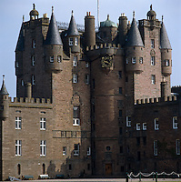 The clock tower and frontage of Glamis Castle seen from the drive